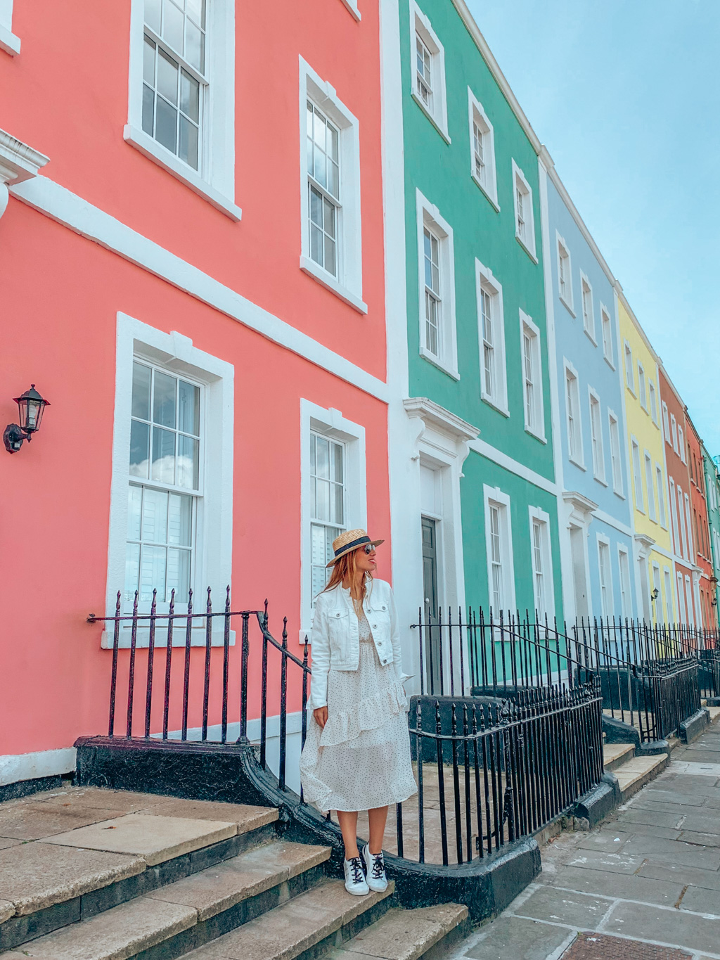 girl and colorful houses